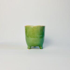 Zielona osłonka na nóżkach